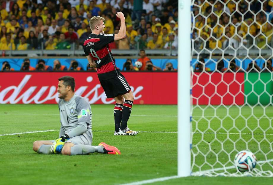 BELO HORIZONTE, BRAZIL - JULY 08:  Andre Schuerrle of Germany celebrates scoring his team's sixth goal past goalkeeper Julio Cesar of Brazil during the 2014 FIFA World Cup Brazil Semi Final match between Brazil and Germany at Estadio Mineirao on July 8, 2014 in Belo Horizonte, Brazil.  (Photo by Martin Rose/Getty Images) Photo: Martin Rose, Getty Images