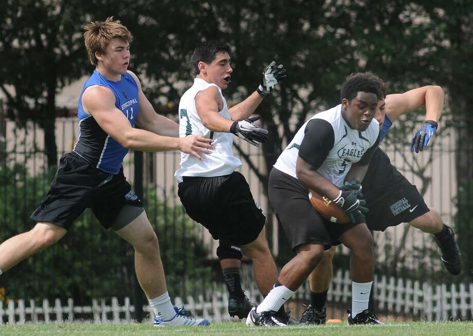 Ft. Bend Christian Justin Wherry snags the ball away from Episcopal junior Trey Home, from left, and teammate Kevin Imperio during their game at a state 7-on-7 football qualifier at Episcopal High School. Freelance photo by Jerry Baker Photo: Jerry Baker, Freelance / Freelance