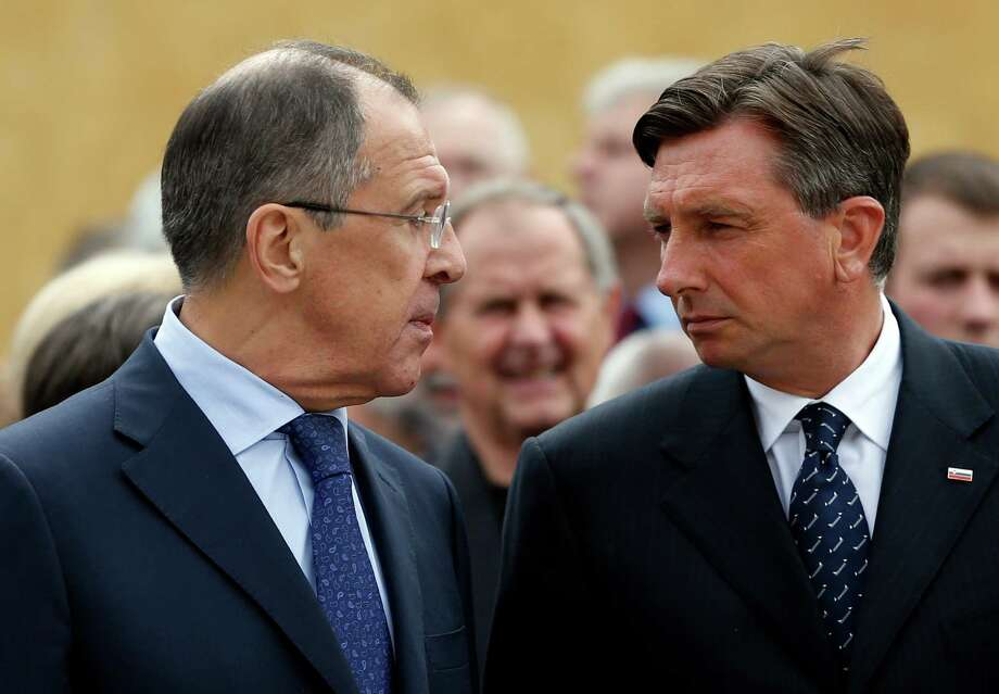 Russia's foreign minister Sergey Lavrov, left, and Slovenia's President Borut Pahor look at each other in Maribor, Slovenia, Tuesday, July 8, 2014, during the opening ceremony for a museum commemorating WWII camp for captured Soviet prisoners of war. (AP Photo/Darko Bandic) ORG XMIT: XDB101 Photo: Darko Bandic / AP