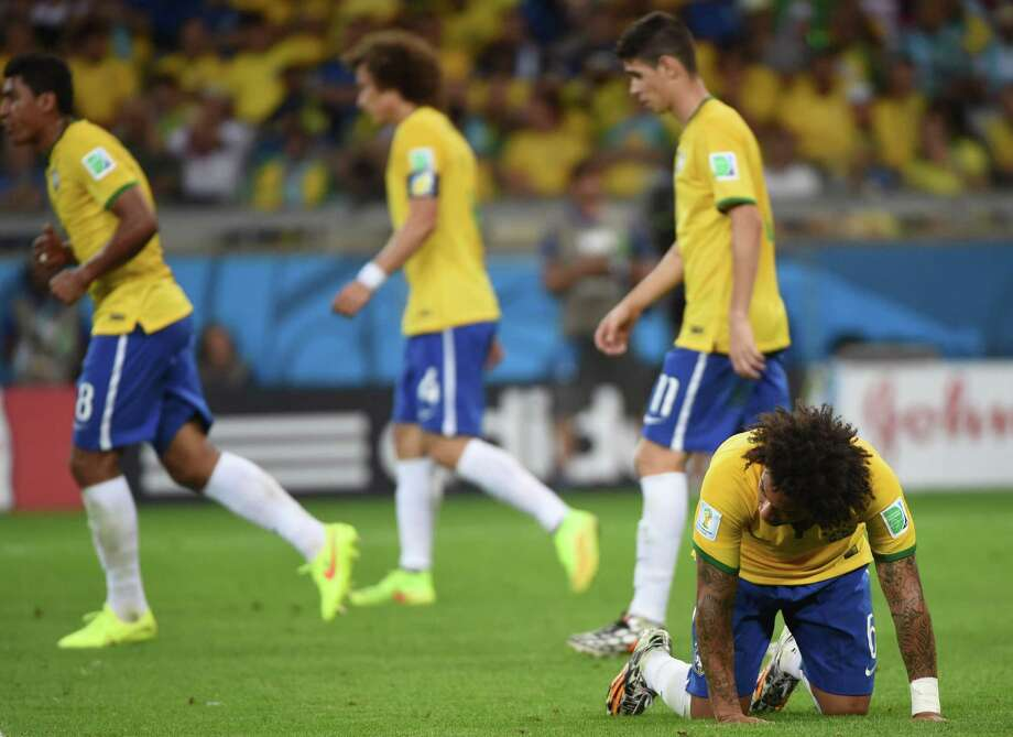 "2014 World Cup semifinalWithout Neymar and Thiago Silva, it was always going to be tough for Brazil to come out on top Tuesday against a well-oiled German side. But 7-1? The loss equaled Brazil's worst ever and was one heck of a way to snap its 39-game home winning streak. Manager Luiz Felipe Scolari called Tuesday the ""worst day of my life;"" it's not hard to see why after the host nation surrendered goals to five different German players and trailed 5-0 after just 30 minutes. Photo: PEDRO UGARTE, AFP/Getty Images / AFP"