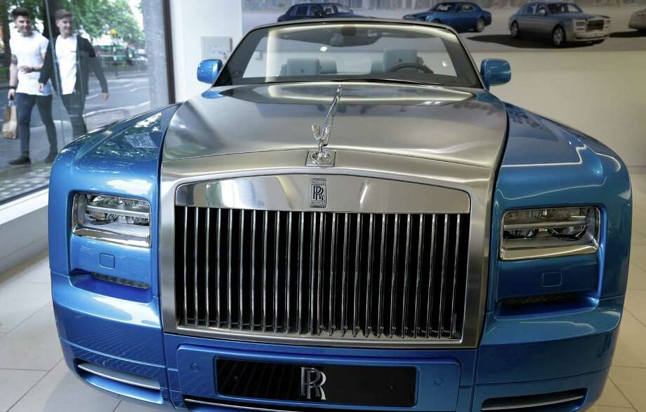 A showroom in London displays a special edition Phantom Drophead Coupe Rolls-Royce. Photo: Kirsty Wigglesworth, STF / AP