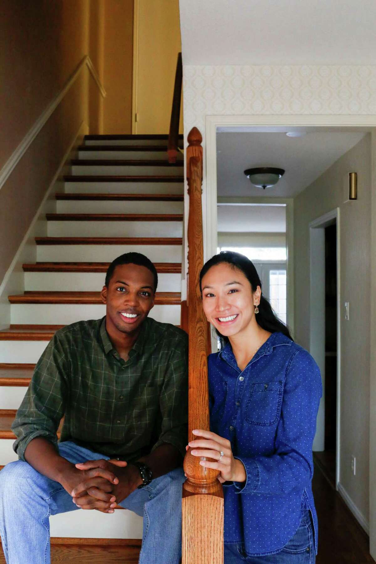 Newlyweds Esther and Brandon Hendricks in their town home June 28, 2014 in Houston.