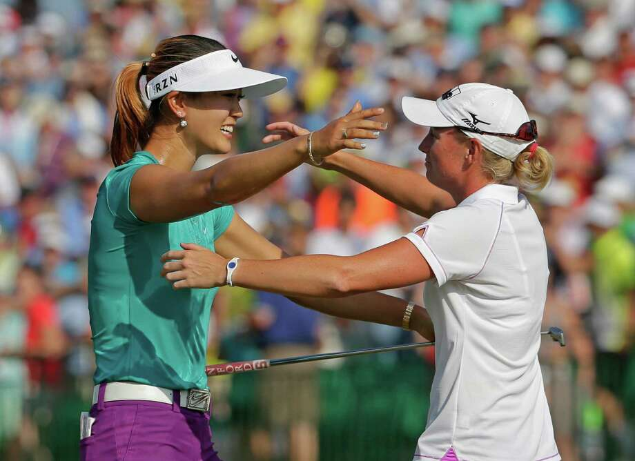 FILE - In this June 22, 2014, file photo, Michelle Wie, left, is embraced by runner-up Stacy Lewis after winning the U.S. Women's Open golf tournament in Pinehurst, N.C.  One is tall and powerful, the other compact and precise. Wie and Lewis, for all their differences, have become fast friends in golf. They're also leading an American revival, which resumes this week at Royal Birkdale. (AP Photo/Chuck Burton, File) Photo: Chuck Burton, STF / AP