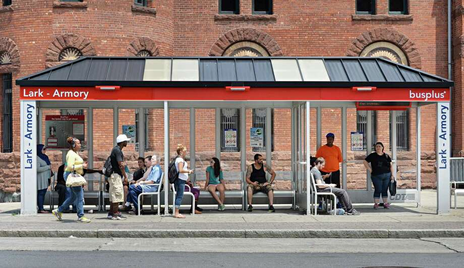 Riders await their bus at a shelter on Washington Avenue outside the Armory Tuesday, July 8, 2014, in Albany, N.Y.  (John Carl D'Annibale / Times Union) Photo: John Carl D'Annibale / 00027700A