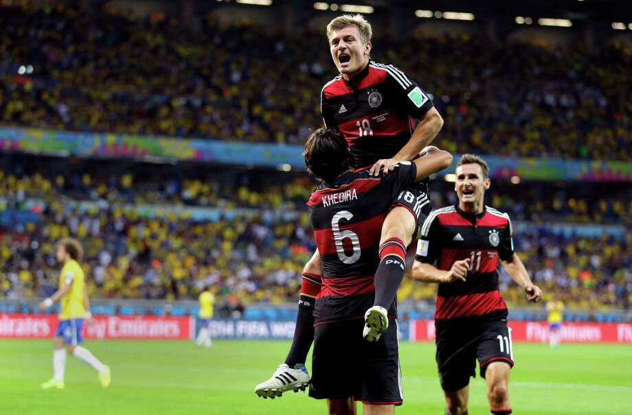 Germany's Toni Kroos celebrates with Sami Khedira (6) and Miroslav Klose (11) after scoring his side's fourth goal during the World Cup semifinal soccer match between Brazil and Germany at the Mineirao Stadium in Belo Horizonte, Brazil, Tuesday, July 8, 2014. (AP Photo/Natacha Pisarenko) ORG XMIT: WCDP548 Photo: Natacha Pisarenko / AP