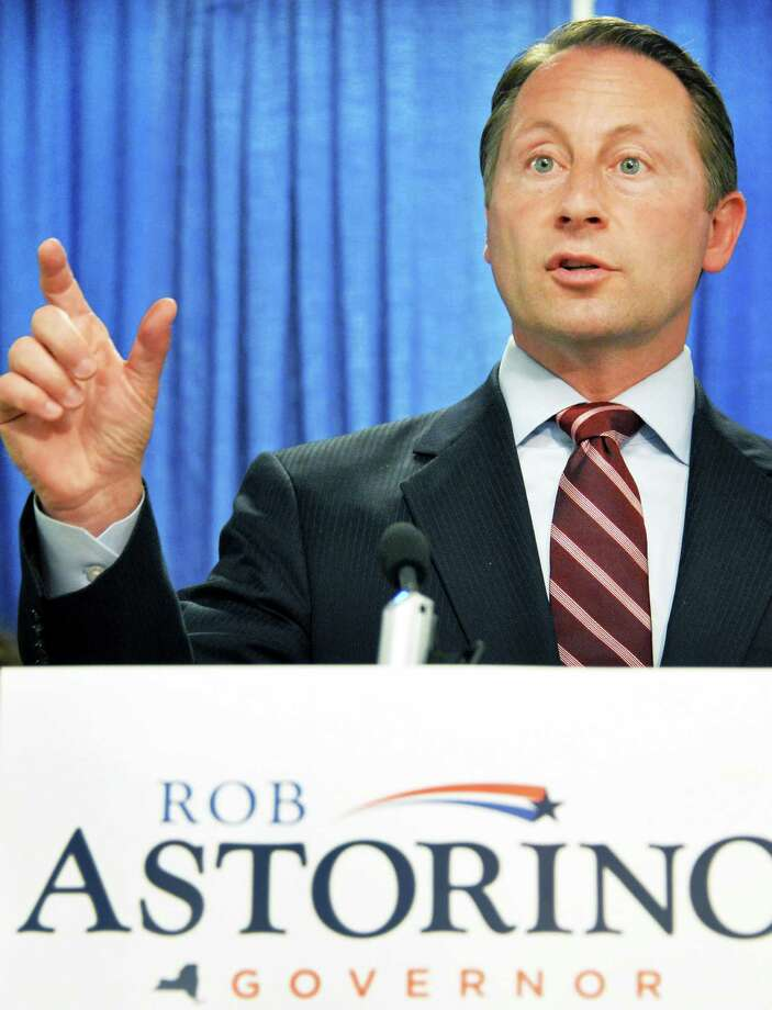 Republican gubernatorial candidate Rob Astorino, center, speaks at a news conference on Common Core Tuesday July 8, 2014, at the Legislative Office Building in Albany, N.Y.  (John Carl D'Annibale / Times Union) Photo: John Carl D'Annibale / 00027688A