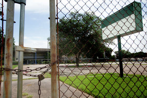 An empty school sign sits in front of the vacant Terrell Jr. High School, Tuesday, July 8, 2014, in Houston. Federal officials toured the campus as a potential choice for housing immigrant children that have crossed the border into the US. The school was closed in 2001 and is now being used for storage. (Cody Duty / Houston Chronicle)