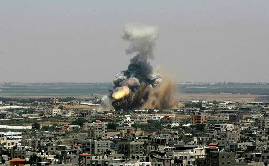 An Israeli missile explodes on impact in Rafah in the southern Gaza Strip on Tuesday. The Israeli military launched what could be a long-term offensive. Photo: Eyad Baba, STR / AP