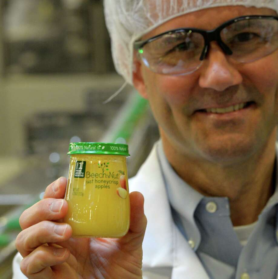 Jeff Boutelle, president and CEO holds a freshly bottled natural honey crisp applesauce at the Beechnut plant Monday afternoon March 10, 2014, in Florida, N.Y.  (Skip Dickstein / Times Union) Photo: SKIP DICKSTEIN / 00026005A