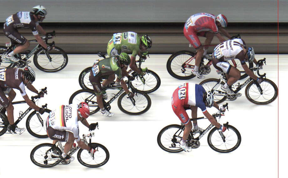 Marcel Kittel of Germany (front) edges Norway's Alexander Kristoff (top) and Arnaud Demare of France in a photo finish in the fourth stage of the Tour de France. Many race experts say Wednesday's fifth stage could start to separate the race contenders. Photo: Associated Press / ASO