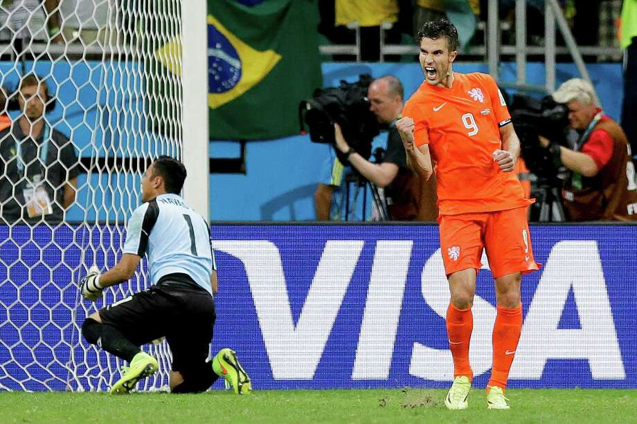 Due to a stomach ailment, Dutch captain Robin van Persie wasn't feeling as chipper Tuesday as when he nailed a penalty kick in the shootout against Costa Rica in the quarterfinals. Photo: Matt Dunham, STF / AP