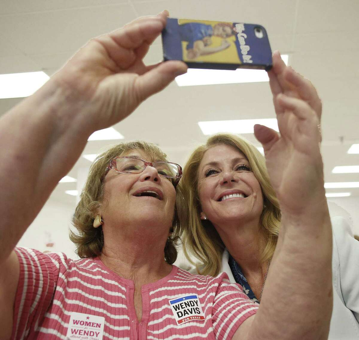 Doris Gluck, left, takes a selfie with Texas Democratic gubernatorial candidate Wendy Davis at her La Gran Plaza campaign office in Fort Worth, Texas on Tuesday, July 8, 2014. Davis spoke about Texans' right to know where hazardous chemicals are stored in their communities. (AP Photo/Fort Worth Star-Telegram, Ron T. Ennis)
