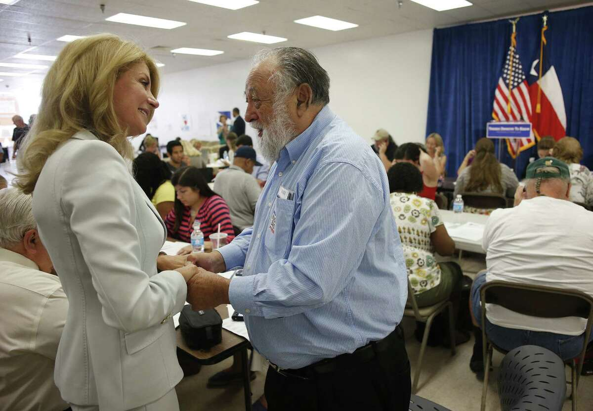 """Democratic gubernatorial candidate Wendy Davis greets Dr. Julian Haber, who she worked for in high school, while visiting her campaign office in La Gran Plaza in Fort Worth. The stop was part of her """"Texans Deserve to Know Tour."""""""