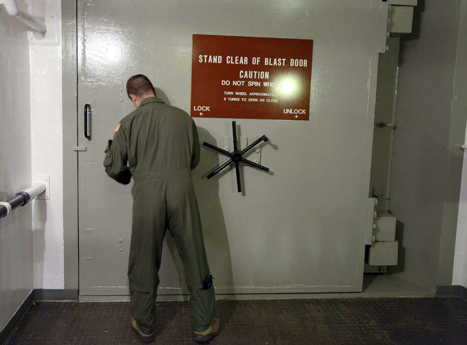 Missile officer 1st Lt. Phil Parentrau opens the blast door leading to the underground control room at an ICBM launch control facility near Minot, N.D Photo: Associated Press / AP