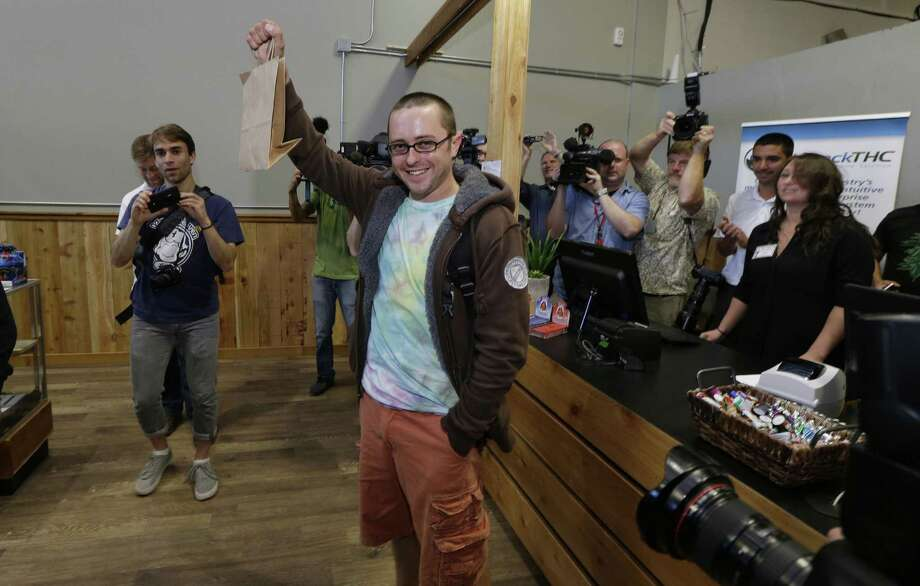 Cale Holdsworth of Abeline, Kan., was the first person to buy legal recreational pot at Top Shelf Cannabis in Bellingham, Wash. Photo: Ted S. Warren / Associated Press / AP