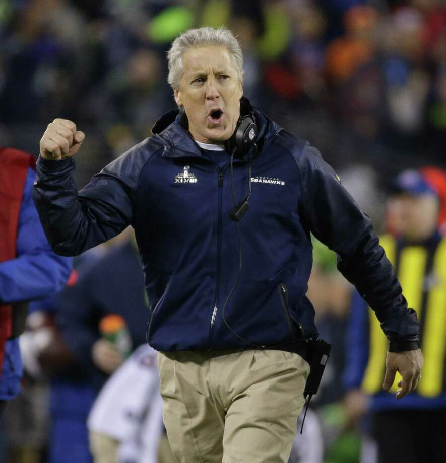 Head coach Pete Carroll of the Seattle Seahawks celebrates after an interception return for a touchdown against the Denver Broncos in the first half of Super Bowl XLVIII at MetLife Stadium in East Rutherford, N.J., on Sunday, Feb. 2, 2014. (Mark Cornelison/Lexington Herald-Leader/MCT) Photo: Mark Cornelison, MBR / Lexington Herald-Leader