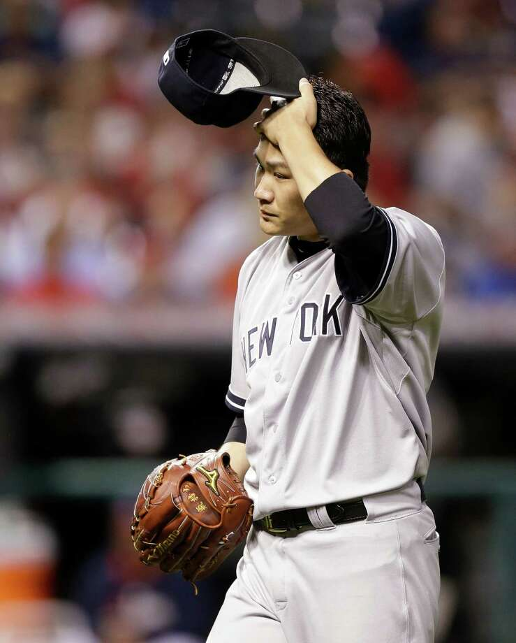 New York Yankees starting pitcher Masahiro Tanaka walks to the dugout in the seventh inning of a baseball game against the Cleveland Indians Tuesday, July 8, 2014, in Cleveland. Tanaka pitched 6 2/3 innings and gave up 10 hits and five runs. (AP Photo/Tony Dejak) ORG XMIT: OHTD117 Photo: Tony Dejak / AP