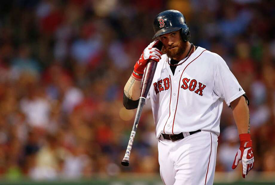 BOSTON, MA - JULY 08:  Jonny Gomes #5 of the Boston Red Sox reacts after striking out against the Chicago White Sox during the game at Fenway Park on July 8, 2014 in Boston, Massachusetts.  (Photo by Jared Wickerham/Getty Images) ORG XMIT: 477586145 Photo: Jared Wickerham / 2014 Getty Images
