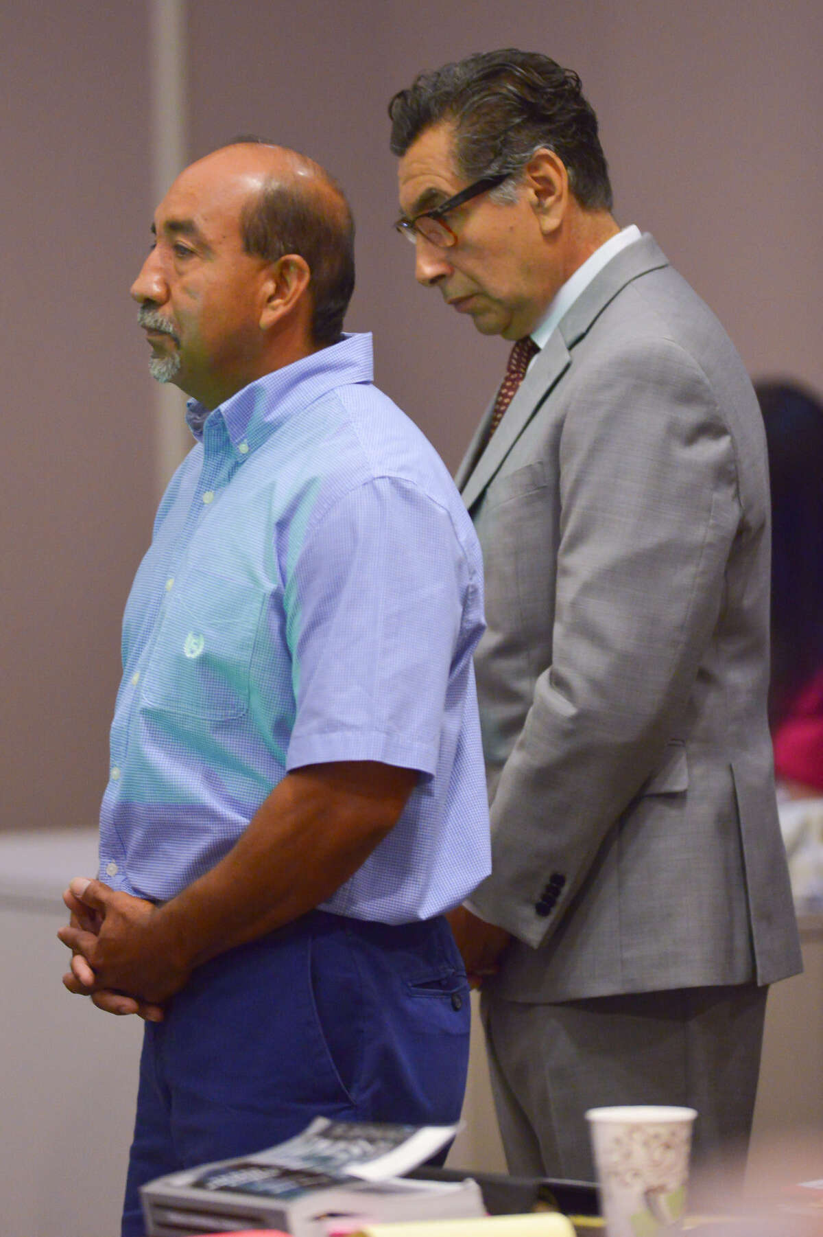 Adrian Perryman (left) stands with his attorney Tony Jimenez at the start of his trial.
