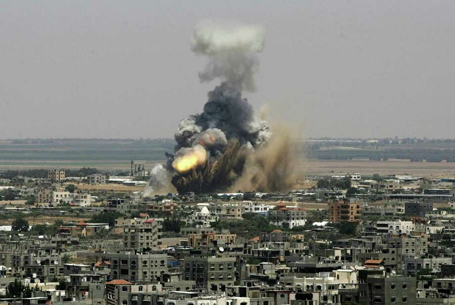 An Israeli missile explodes on impact in Rafah in the Gaza Strip. Israel launched an aerial offensive against Islamic militants after weeks of rocket fire directed against the Jewish state. Photo: Eyad Baba / Associated Press / AP