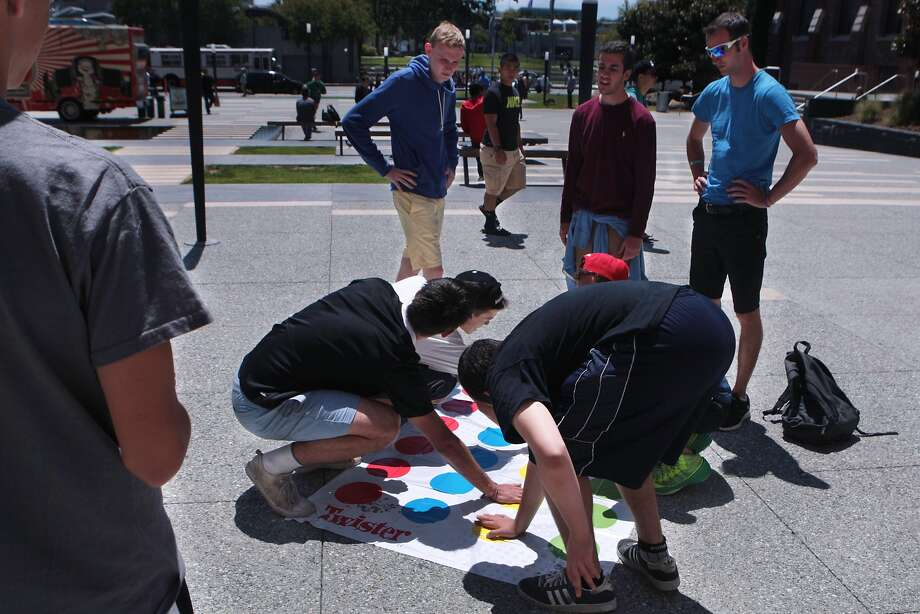 Teens from a Pennsylvania summer camp play Twister during a lunchtime board games event at Jessie Square Plaza at the Contemporary Jewish Museum in San Francisco, Calif. on Tuesday, July 8, 2014. The event will take place on Tuesdays July 15, 22, 29 and August 12, 19 and 26 from noon to 1 p.m. Photo: Kevin N. Hume, The Chronicle