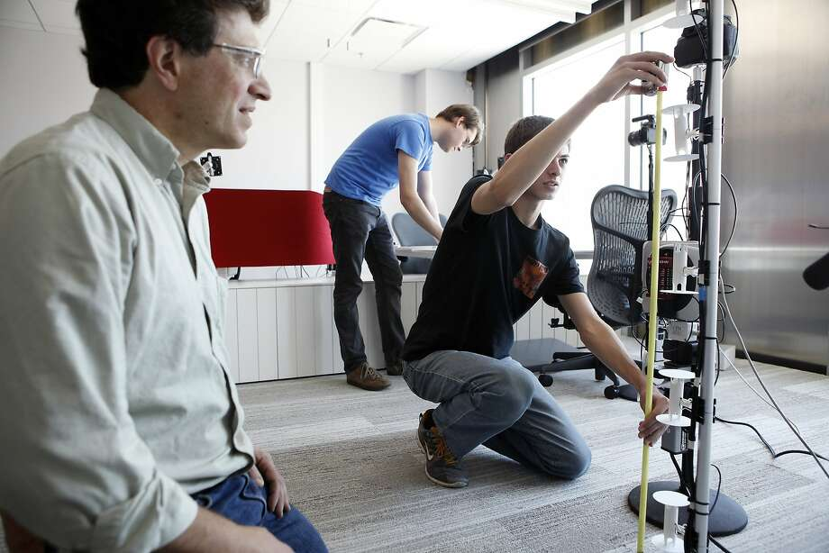 The new Flexlab facility at Lawrence Berkeley National Laboratory lets researchers test energy-saving technologies and materials for buildings, including lights, windows and air conditioning systems. Sensors inside the lab constantly check light levels and temperature, while other equipment monitors energy use. Here, Senior Scientific Engineering Associate Jonathan Slack, left, works with Student Assistants Ryan Dickerhoff and Ray Karam as they take measurements of instruments.  Photo: Michael Short, The Chronicle
