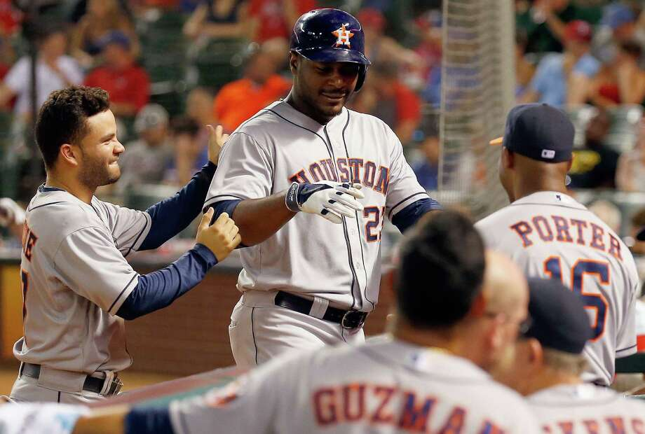 Houston's Chris Carter is welcomed to the dugout by Jose Altuve (left) and manager Bo Porter after his eighth-inning homer. Photo: Tom Pennington / Getty Images / 2014 Getty Images