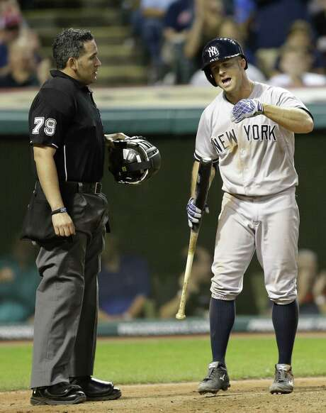 Brett Gardner of the Yankees argues with umpire Manny Gonzalez after striking out looking in the seventh inning. Photo: Tony Dejak / Associated Press / AP