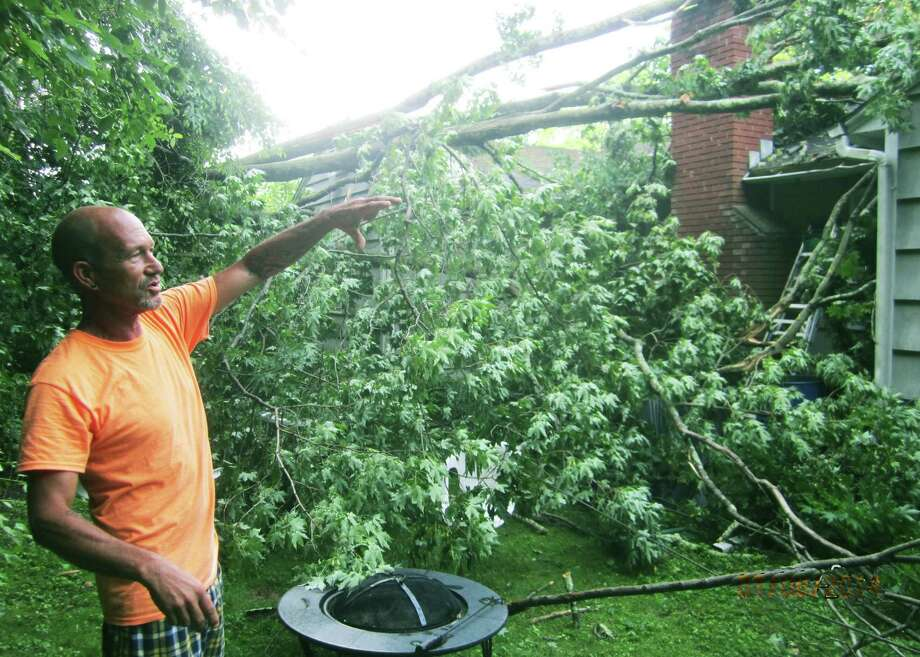 Chris Nuremberg of New Milford explains possible damage to his Northville home as the result of Monday's windstorm. July 7, 2014 Photo: Norm Cummings / The News-Times