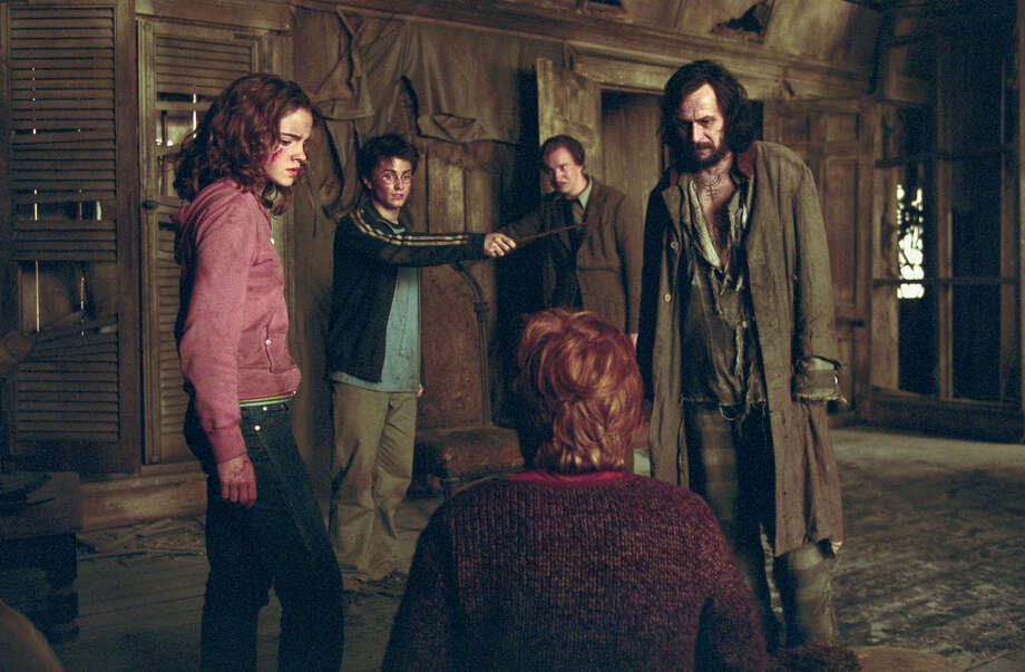 """** ADVANCE FOR THURSDAY, JAN. 22 **Actors from left, Emma Watson as Hermione Granger, Daniel Radcliffe as Harry Potter, David Thewlis as Professor Lupin, Gary Oldman as Sirius Black and Rupert Grint (back to camera) as Ron Weasley appear in a scene from """"Harry Potter and the Prisoner of Azkaban,"""" in this undated publicity photo. The sequel will open in June 2004. (AP Photo/Warner Bros. Pictures, Murry Close HO) Photo: MURRY CLOSE, HO / WARNER BROS PICTURES"""