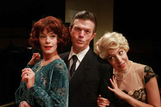 Derrick Brent II, from left, Jason Carmichael and Dennis Spears, as Nat King Cole, star in the Ensemble Theatre's production of