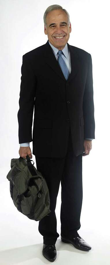 Charlie Gonzalez never travels without his trusty bag. / San Antonio Express-News