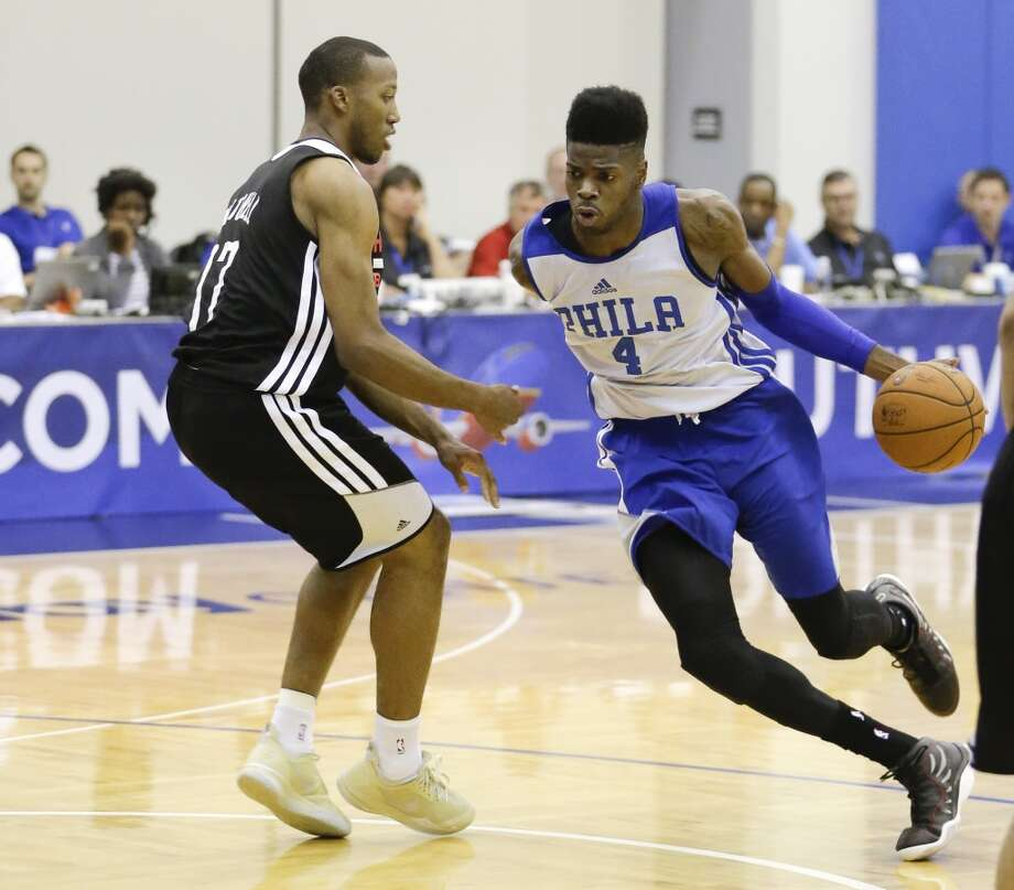 Philadelphia's Nerlens Noel drives around Akil Mitchell. Photo: John Raoux, Associated Press