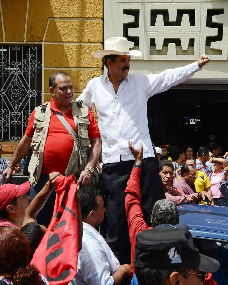 Former Honduran President Manuel Zelaya (center) greets supporters. Photo: Orlando Sierra, AFP/Getty Images