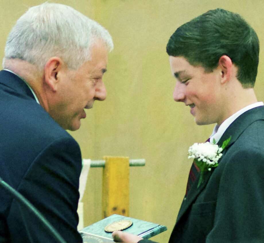 Assistant principal Leonard Gulotta presents the Norman Stoddard Sports Award, given in memory of a 1960s Kent Center School graduate who later died in Vietnam, to a proud Dylan Stewart. Mia Kartchner was the girls' Stoddard recipient during KCS' June 17, 2014 graduation ceremony. Photo: Trish Haldin / The News-Times Freelance
