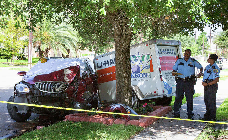 Police labor at the scene of a fatal wreck in the 1900 block of Binz Street, Wednesday, July 9, 2014, in Houston. Photo: Cody Duty, Houston Chronicle / © 2014 Houston Chronicle