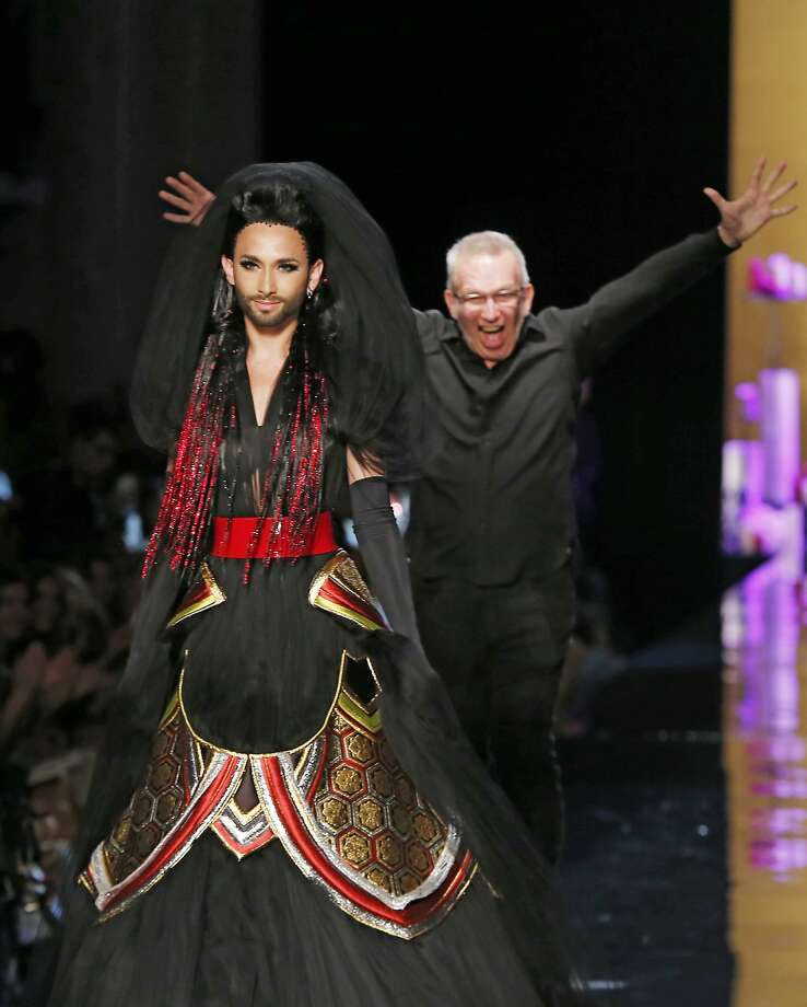 Gualtier's new model: French designer Jean-Paul Gaultier hams it up behind singer Conchita Wurst at Gaultier's Fall Winter 2014-15 Haute Couture collection in Paris. Photo: Jacques Brinon, Associated Press