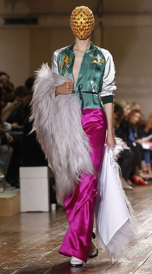 When all else fails to get you noticed, wear a Faberge egg on your head: A model shows a creation for Maison Martin Margiela's Fall-Winter 2014-2015 Haute Couture fashion collection in Paris. Photo: Remy De La Mauviniere, Associated Press
