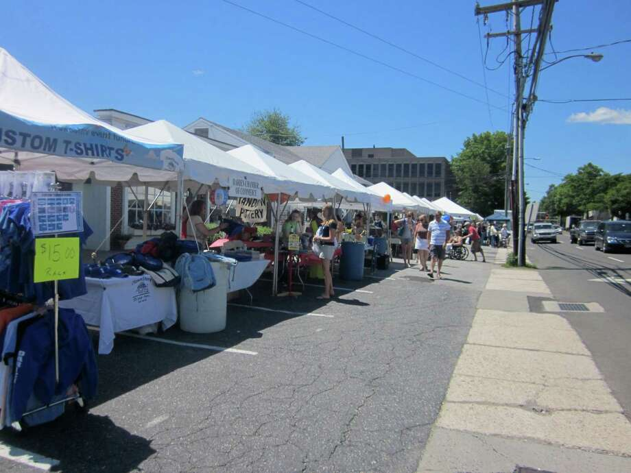 Shoppers looking for bargains can browse tents set up along the Post Road at the Darien Sidewalk Sale and Family Fun Days. - Photo by John H. Palmer Photo: File Photo, ST / Darien News