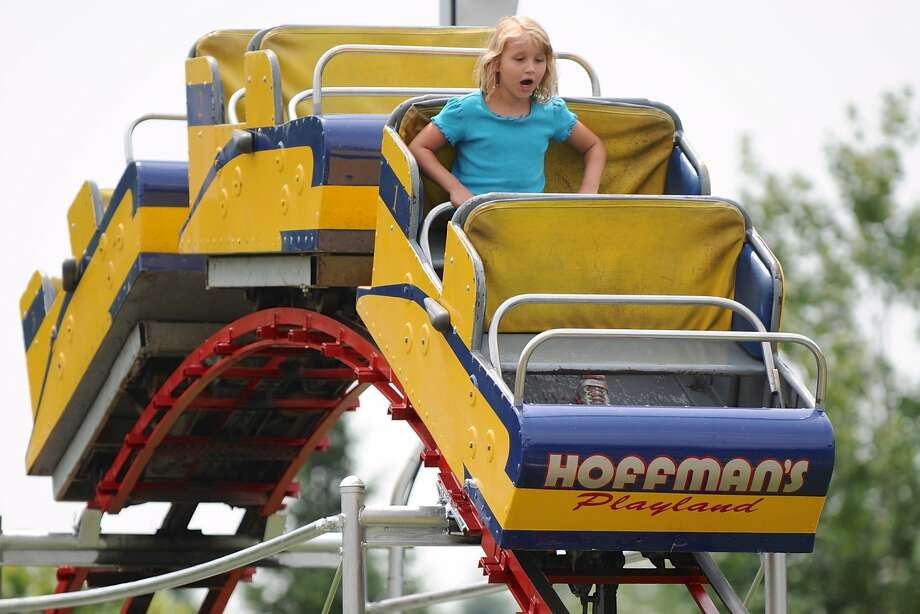 Playland's days are numbered: Seven-year-old Julia Songayllo rides an empty roller coaster car at Hoffman's Playland in Latham, N.Y. This is the final season Hoffman's will be open for business. Photo: Stacey Lauren-Kennedy, Associated Press