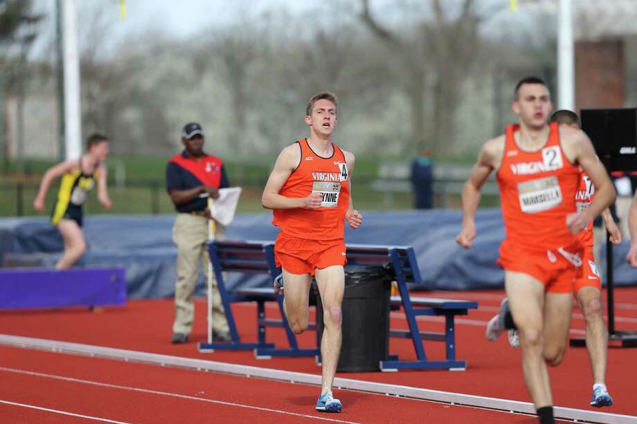 Former Staples track star and current University of Virginia sophomore, Henry Wynne, left, runs in the 1,500 meter race during a meet with Cal and Michigan on April 5, 2014. Photo: UVA Athletics/Contributed Photo / Westport News Contributed