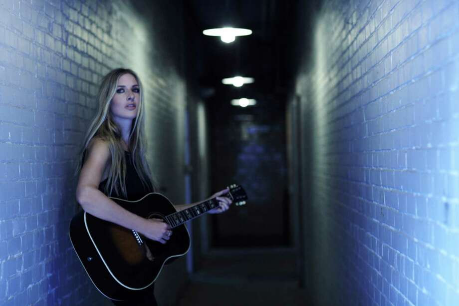 Holly Williams will perform Friday in Houston. The granddaughter of Hank Williams Sr. says she draws inspiration from being on the road. Photo: Kristen Barlowe