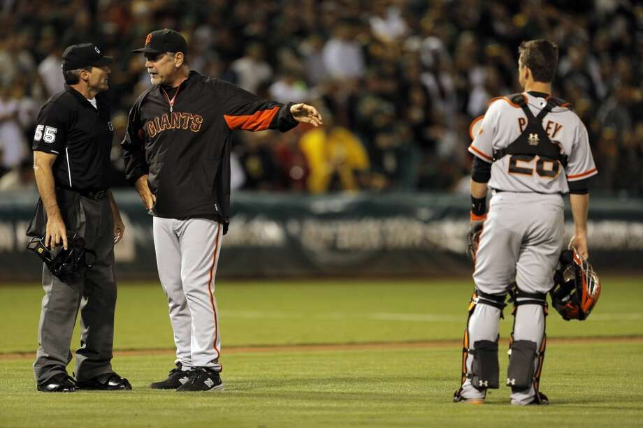 Giants manager Bruce Bochy argues with homeplate umpire Angel Hernandez after Hernandez called a balk on pitcher Jean Machi in the eighth inning as the Oakland Athletics played the San Francisco Giants on Tuesday, July 8, 2014, at O.co Coliseum in Oakland, Calif. Photo: The Chronicle
