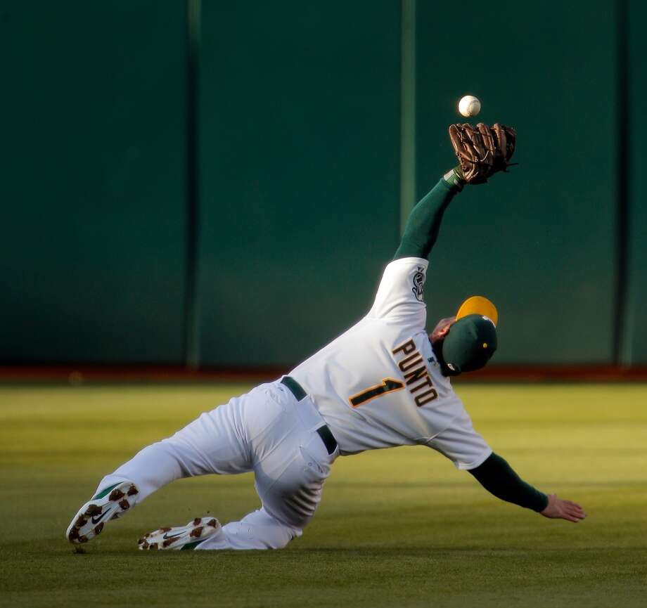 Nick PUnto of the A's drops a single by Hunter Pence of the Giants as the Oakland Athletics played the San Francisco Giants on Tuesday, July 8, 2014, at O.co Coliseum in Oakland, Calif. Photo: The Chronicle