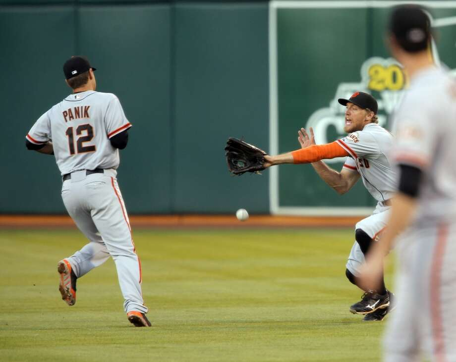 Hunter Pence (8) can't reach a ball hit by Jed Lowrie (8) in the third inning as the Oakland Athletics played the San Francisco Giants on Tuesday, July 8, 2014, at O.co Coliseum in Oakland, Calif. Photo: The Chronicle