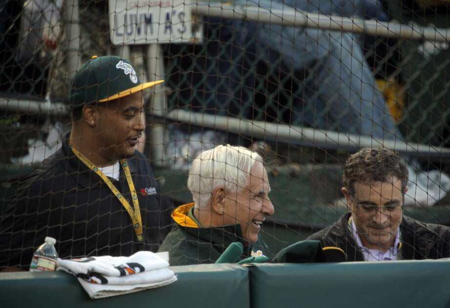 A's owner Lew Wolff, center, smiles in the third inning as the A's scored multiple times as the Oakland Athletics played the San Francisco Giants on Tuesday, July 8, 2014, at O.co Coliseum in Oakland, Calif. Photo: The Chronicle