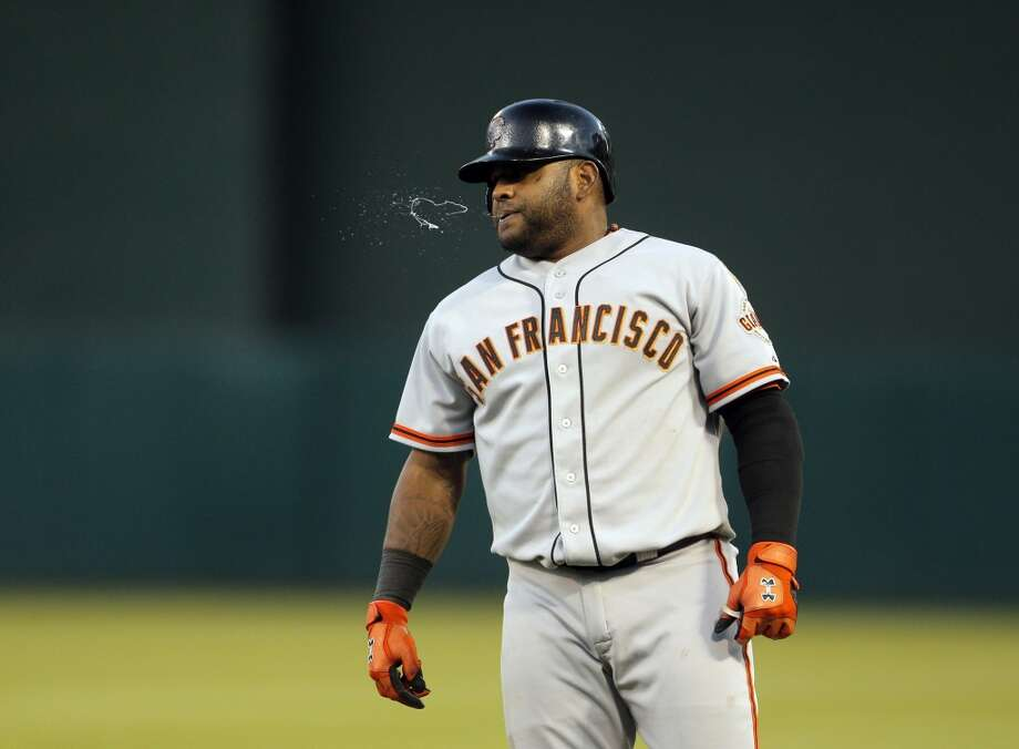 Pablo Sandoval spits after being called out at first in the sixth inning as the Oakland Athletics played the San Francisco Giants on Tuesday, July 8, 2014, at O.co Coliseum in Oakland, Calif. Photo: The Chronicle