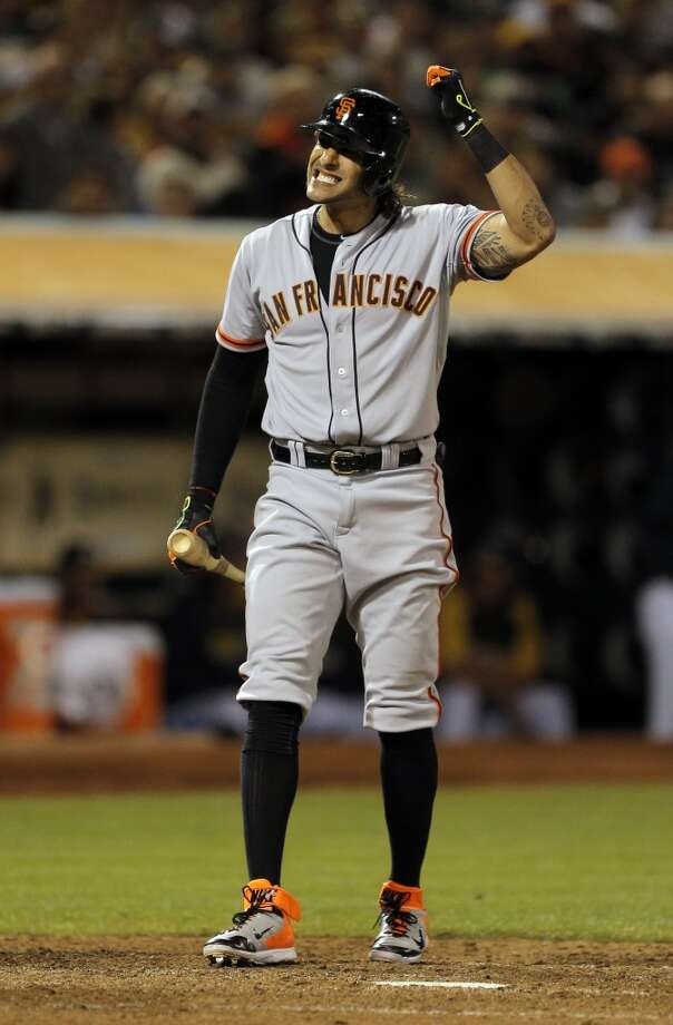 Michael Morse (38) reacts to swinging at a pitch in the eighth inning as the Oakland Athletics played the San Francisco Giants on Tuesday, July 8, 2014, at O.co Coliseum in Oakland, Calif. Photo: The Chronicle