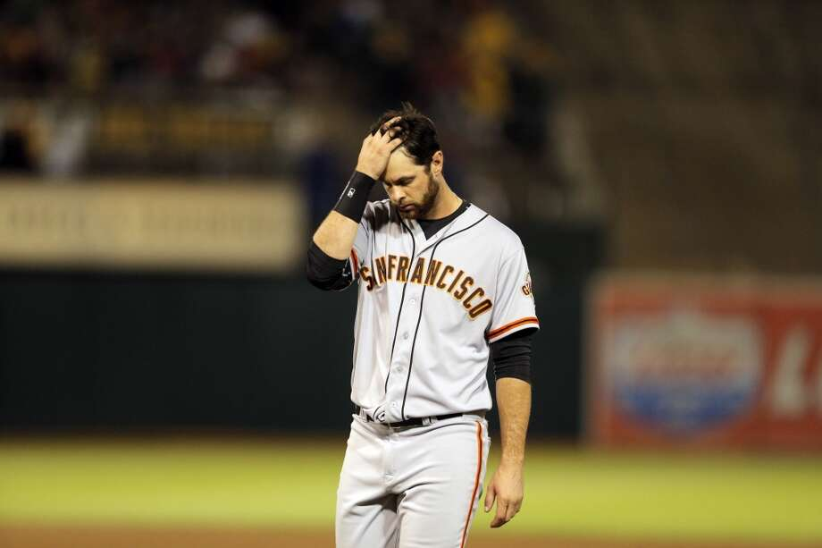 Brandon Belt walks off the field after getting stranded at second in the eighth inning as the Oakland Athletics played the San Francisco Giants on Tuesday, July 8, 2014, at O.co Coliseum in Oakland, Calif. Photo: The Chronicle