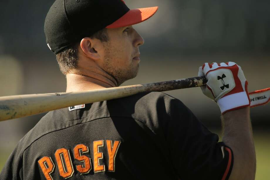 Buster Posey (28) of the Giants during warm ups before the game as the Oakland Athletics played the San Francisco Giants on Tuesday, July 8, 2014, at O.co Coliseum in Oakland, Calif. Photo: The Chronicle